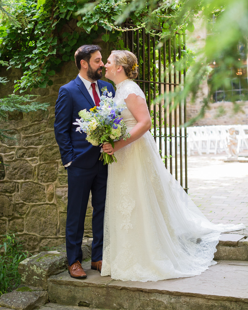 bride and groom next to wrought iron gate at HollyHedge Estate by Laura Billingham Photography