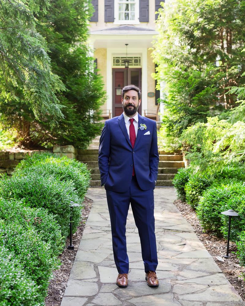 Elegantly dressed groom outside HollyHedge Estate