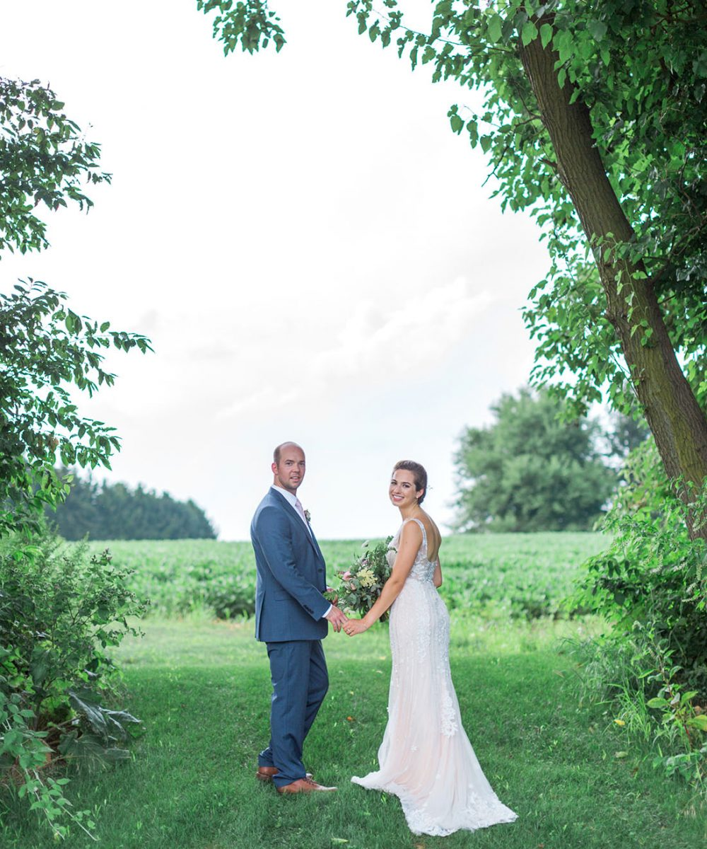Rustic elegant bride and groom at Wyndridge Farm in York, PA photographed by Laura Billingham